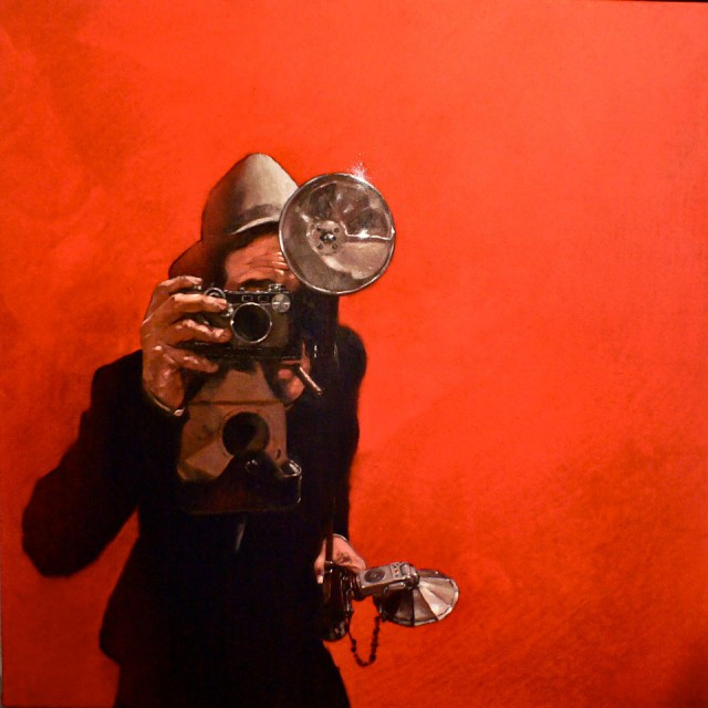 Photographer on Red by Will Rochfort